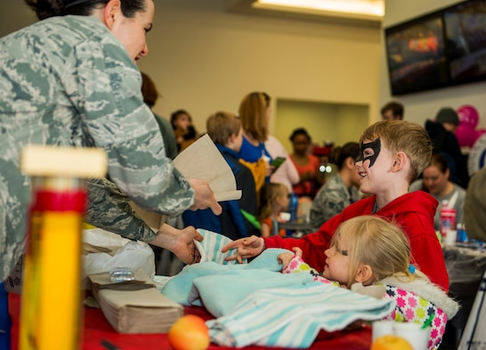 U.S. Air Force Capt. Denise Campbell, 52nd Aerospace Medicine Squadron health promotion dietitian, right, interacts with Cael and Keira Dell, children of U.S. Air Force Staff Sgt. Brady Dell, a 52nd Component Maintenance Squadron jet engine intermediate maintenance crew supervisor, during the Spring Fling event in the Base Exchange at Spangdahlem Air Base, Germany, April 15, 2016. The EFMP works with military families with special needs children to address and accommodate their specific needs at their installation. (U.S. Air Force photo by Airman 1st Class Timothy Kim/Released)