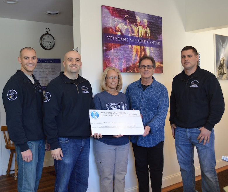 The 109th Company Grade Officers' Council donated $4,500 to the Veterans Miracle Center in Albany, New York, on April 14, 2016, from funds raised during the coucil's annual golf tournament in September. Pictured are (from left) 1st Lt. Jared Semerad; Capt. James Vendetti, CGO Council president; Melody Burns, VMC Director of Operations; Barry Feinman, Jezreel International CEO; and Capt. Shawn Rulsion. (U.S. Air National Guard photo by Tech. Sgt. Catharine Schmidt/Released)