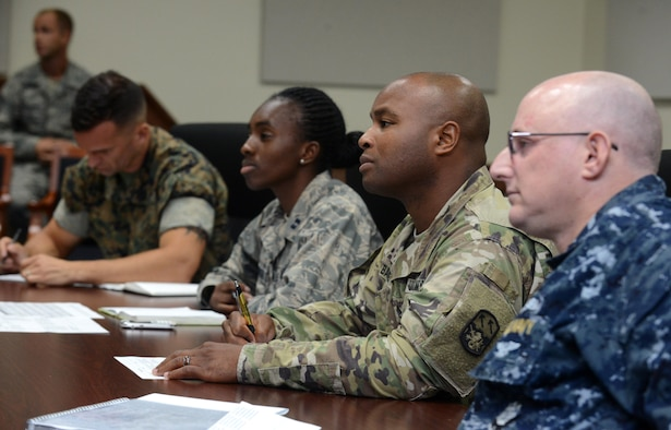 Board members listen to service members' answers during a Sexual Assault Prevention and Response competition April 27, 2016, at Andersen Air Force Base, Guam. To conclude the Sexual Assault Awareness and Prevention Month, Task Force Talon, 36th Wing, Joint Region Marianas and Marine Corps Activity Equal Opportunity/SAPR offices conducted a joint competition to promote esprit de corps and bring awareness to the SAPR programs. (U.S. Air Force photo by Airman 1st Class Arielle Vasquez/Released)