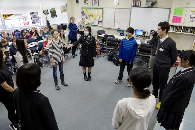 Students from Noda Gakuen High School in Yamaguchi City and Matthew C. Perry High School at Marine Corps Air Station Iwakuni, Japan, participate in a drama class at MCAS Iwakuni April 21, 2016. Events like these help secure the two nations' relationship with positive activities that educate students about each other's culture. (U.S. Marine Corps photo by Lance Cpl. Aaron Henson/Released)