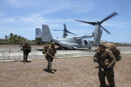 Marines disembark from an MV-22 Osprey after landing at an airstrip in Panay, Philippines, during Exercise Balikatan, Monday, April 11, 2016. The Marines were acting as a follow-up force for an earlier amphibious landing by Filipino marines. (Stars and Stripes/Wyatt Olson)