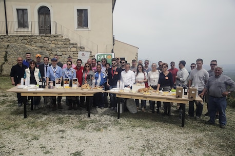 Marines with Special Purpose Marine Air-Ground Task Force Crisis Response-Africa Logistics Combat Element, stand behind a table with lunch provided by the volunteers at Castello di Lombardia in Enna, Sicily, during a community relations project on April 22, 2016.  Marines assist local areas in various projects to build relationships with the Sicilian government and people.  (U.S. Marine Corps photo by Cpl. Alexander Mitchell/released)