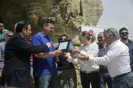Lt. Arthur Briggs, the chaplain with Special Purpose Marine Air-Ground Task Force Crisis Response-Africa Logistics Combat Element, receives an award on behalf of the Marines and sailors volunteering at Castello di Lombardia in Enna, Sicily, during a community relations project on April 22, 2016.  Marines assist local areas in various projects to build relationships with the Sicilian government and people.  (U.S. Marine Corps photo by Cpl. Alexander Mitchell/released)