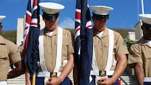 A Marine color guard, featuring the Australia and New Zealand national colors, bow their heads during prayer at the National Memorial Cemetery of the Pacific in Oahu, Hawaii, April 25, 2016. This is the 44th year U.S. Marines have participated in the commemoration of the Australia New Zealand Army Corps Day, highlighting a long-lasting friendship between the three countries.