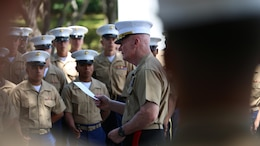 Lt. General John A. Toolan addresses the Marines who participated in the Australia New Zealand Army Corps Day Commemoration ceremony at the National Memorial Cemetery of the Pacific April 25, 2016. Toolan is the commander of Marine Corps Forces, Pacific. Toolan highlighted the significance of ANZAC day when he focused on the long-lasting friendship between the three nations that continues to the present day.