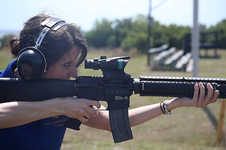 Heather, the LINKS Lifeskills Trainer of the 6th Marine Corps District, fires down range at the firing range aboard Marine Corps Recruit Depot Parris Island, S.C., April 27, 2016. The teachers, coaches, and principals of Recruiting Stations Baton Rouge and Nashville participate in a three-day workshop designed to inform educators about military service and life in the Marine Corps. (Official Marine Corps photo Cpl. John-Paul Imbody)