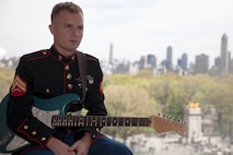 Corporal Mike Borowski poses for a photo at The Jazz at Lincon Center overlooking New York's Central Park, Saturday, April 23, 2016. Borowski, who once lived gig-to-gig looking for work as a musician now travels across the country with the Marine Band San Diego.