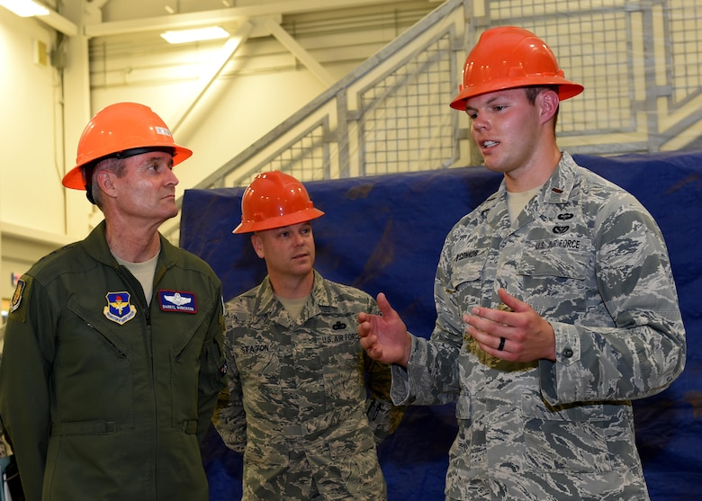 U.S. Air Force 2nd Lt. Jesse O'Connor, 97th Civil Engineer Squadron KC-46 program manager, gives U.S. Air Force Lt. Gen. Darryl Roberson, commander of Air Education Training Command and Chief Master Sgt. David Staton, AETC command chief, a tour of the future KC-46 Pegasus squadron building, April 25, 2016, at Altus Air Force Base, Okla. Roberson visited Altus AFB to gain a better understanding of the base's training mission and discuss Air Force topics, including the U.S. Air Force KC-46 Pegasus, the importance of AETC missions and the need for innovation in the U.S. Air Force.  (U.S. Air Force photo by Airman 1st Class Kirby Turbak/Released)