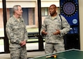 U.S. Air Force Tech. Sgt. Mark Smith, 97th Training Squadron military training leader, explains the improvements done to the 97th TRS dorms to U.S. Air Force Lt. Gen. Darryl Roberson, commander  of Air Education Training Command, April 26, 2016, at Altus Air Force Base, Okla. Roberson visited Altus AFB to gain a better understanding of the base's training mission and discuss Air Force topics, including the U.S. Air Force KC-46 Pegasus, the importance of AETC missions and the need for innovation in the U.S. Air Force.  (U.S. Air Force photo by Airman 1st Class Kirby Turbak/Released)