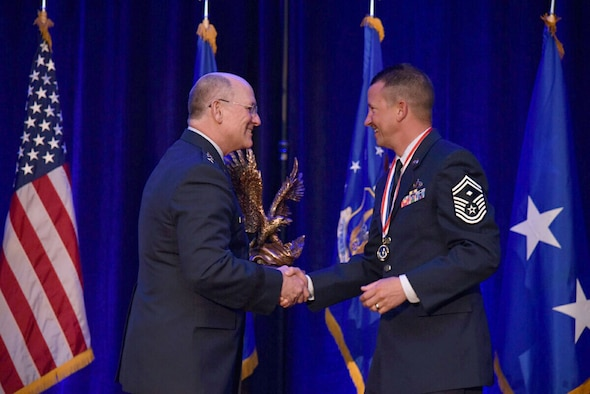 Senior Master Sgt. Matthew Mason, 419th Maintenance Squadron, accepts Air Force Reserve Command's First Sergeant of the Year award from Lt. Gen. James Jackson, chief of Air Force Reserve and commander of AFRC, during a ceremony in Jacksonville, Florida, April 16. (Courtesy photo)