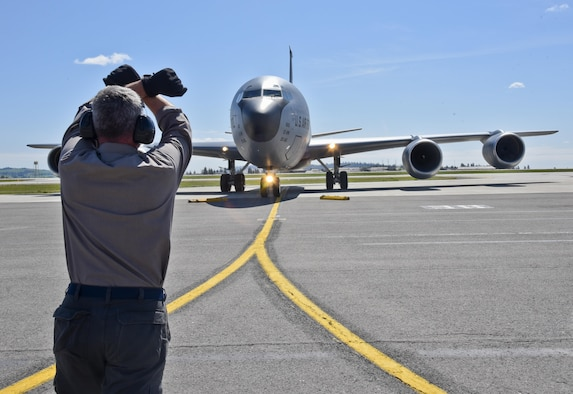 Kenneth Goulding, a 92nd Maintenance Squadron transient alert aircraft servicer, taxies in a KC-135 Stratotanker from McConnell Air Force Base, Kan., April 26, 2016, at Fairchild AFB, Wash. Because of its ramp space, logistical capabilities and maintenance facilities, Fairchild AFB received six KC-135 Stratotankers that were evacuated from McConnell AFB due to projected severe weather. (U.S. Air Force photo/Airman 1st Class Taylor Bourgeous)