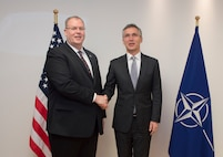 Deputy Defense Secretary Bob Work stands for a photo with NATO Secretary General Jens Stoltenberg at NATO headquarters in Brussels, April 28, 2016. DoD photo by Navy Petty Officer 1st Class Tim D. Godbee