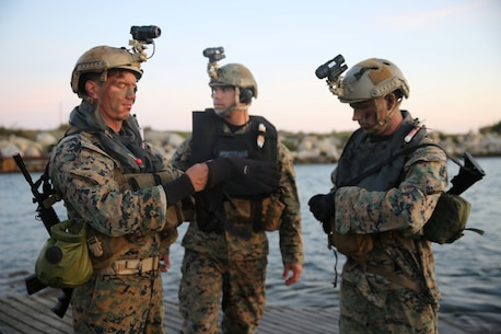 Marines with Company A, 1st Reconnaissance Battalion, 1st Marine Division, check their gear before conducting an amphibious operations training exercise during an Expeditionary Operations Training Group course at Camp Pendleton April 21, 2016. Before executing their mission, Recon Marines tested their Combat Rubber Raiding Craft's top speeds and made sure their gear was secured in preparation for the 11th Marine Expeditionary Unit's deployment in the near future. (U.S. Marine Corps Photo by Cpl. Demetrius Morgan/RELEASED)
