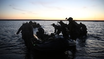 Marines with Company A, 1st Reconnaissance Battalion, 1st Marine Division, carry a Combat Rubber Raiding Craft into the water in order to conduct beach searches during an amphibious operations training exercise, as part of an Expeditionary Operations Training Group course at Marine Corps Base Camp Pendleton, California, April 21, 2016. Recon Marines specialize in providing in-depth reconnaissance on a designated area. This exercise was conducted in preparation for the 11th Marine Expeditionary Unit's deployment in the near future.