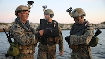 Marines with Company A, 1st Reconnaissance Battalion, 1st Marine Division, check their gear before conducting an amphibious operations training exercise during an Expeditionary Operations Training Group course at Marine Corps Base Camp Pendleton, California, April 21, 2016. Before executing their mission, Recon Marines tested their Combat Rubber Raiding Craft's top speeds and made sure their gear was secured in preparation for the 11th Marine Expeditionary Unit's deployment in the near future.