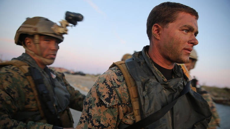 Cpl. Raymond Buckley, right, a reconnaissance man with Company A, 1st Reconnaissance Battalion, 1st Marine Division, prepares for an amphibious operations training exercise during an Expeditionary Operations Training Group course at Marine Corps Base Camp Pendleton, California, April 21, 2016. Buckley said the importance of rehearsing amphibious operations ahead of time is because it serves as the foundation for the 11th Marine Expeditionary Unit deployment and future operations.