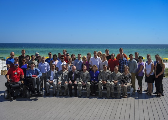 Attendees of the Air Force Special Operations Command Warrior C.A.R.E. Summit gather for a group photo with distinguished visitors at the Hilton Sandestin Beach Golf Resort & Spa April 26, 2016. The summit was designed to give wounded, injured and ill service members and caregivers an opportunity to discover available resources, network with helping agencies, develop mentor relationships and expand their life skills. (U.S. Air Force photo by Senior Airman Meagan Schutter)