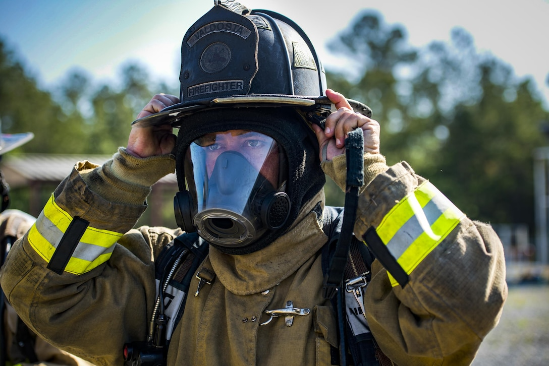 Shelley Miller, Valdosta Fire Department sergeant, gears up during aircraft live fire training, April 27, 2016, at Moody Air Force Base, Ga. Firefighters broke into groups and took turns combating the fire as they would in the field. (U.S. Air Force photo by Airman 1st Class Janiqua P. Robinson/Released)