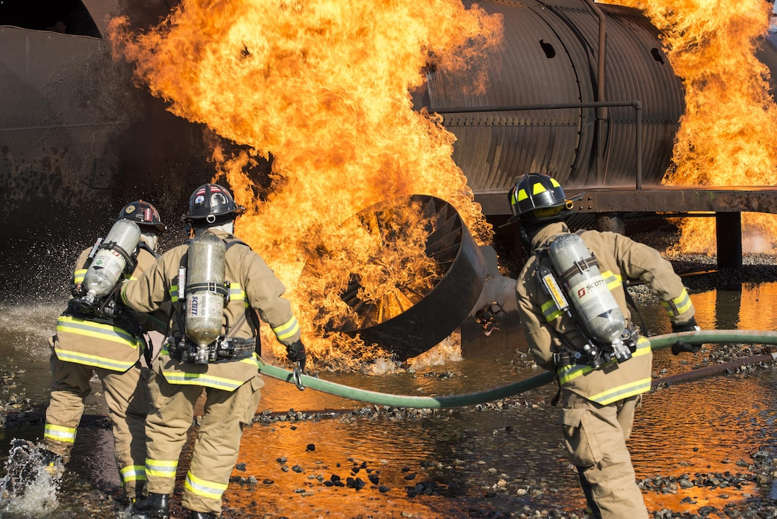 Firefighters from the Valdosta Fire Department rush towards a fire, April 26, 2016, at Moody Air Force Base, Ga. The Federal Aviation Administration requires VFD firefighters to complete aircraft live fire training twice a year. (U.S. Air Force photo by Airman 1st Class Janiqua P. Robinson/Released)