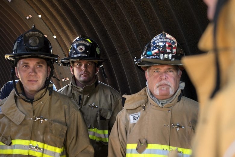 Firefighters from the Valdosta Fire Department listen to a mission brief during a walkthrough of the day's events before aircraft live fire training April 26, 2016, at Moody Air Force Base, Ga. Firefighters were able to see the inside of the training prop and received guidance on where the sources of the fires were, and what type of techniques to use while putting them out. (U.S. Air Force photo by Airman 1st Class Janiqua P. Robinson/Released)