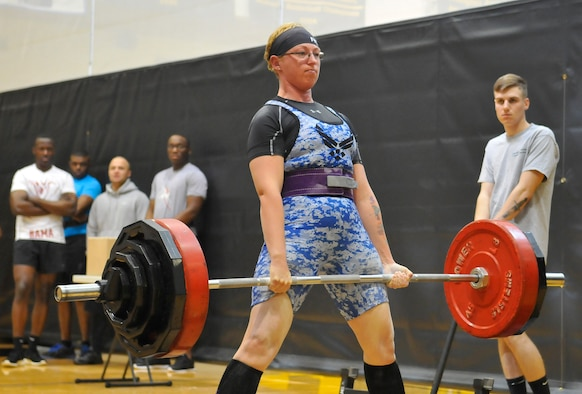 Staff Sgt. April Spilde competes in the deadlift portion of the push, pull and curl competition at Joint Base Myer-Henderson Hall, Va., April 9, 2016. Spilde finished second in her weight class, deadlifting 300 pounds, bench pressing 175 pounds and curling 75 pounds. (U.S. Navy photo/Petty Officer 2nd Class Christopher Hurd)