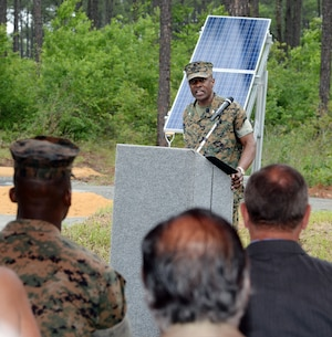 Col. James C. Carroll III, commanding officer, Marine Corps Logistics Base Albany, addresses attendees during a large-scale solar facility ground breaking ceremony held aboard the installation, April 28.