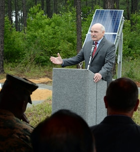 The Honorable Dennis V. McGinn, assistant secretary of the Navy for Energy, Installations & Environment, speaks to attendees during a ground breaking ceremony for a large-scale solar facility held aboard the installation, April 28.