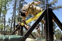 Army Capt. James Teskey dives over an obstacle on an obstacle course during Best Ranger Competition 2016 at Fort Benning, Ga., April 17, 2016. Teskey is assigned to the 2nd Infantry Division. Army photo by Spc. Steven Hitchcock