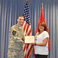 ALBUQUERQUE, N.M. – Ericka Zabala (right) receives a certificate of achievement from District Commander Lt. Col. Patrick Dagon, April 26, 2016. Zabala was recognized as the District's 2016 Administrative Professional of the Year.