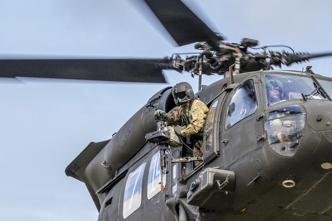An Army UH-60 Black Hawk helicopter supports air assault training with soldiers at Joint Base Lewis-McChord, Wash., April 27, 2016. The battalion-sized air assault allowed the infantry soldiers to train for future missions. The soldiers are assigned to 4th Battalion, 23rd Infantry Regiment, 2nd Stryker Brigade Combat Team. Army photo by Capt. Brian Harris