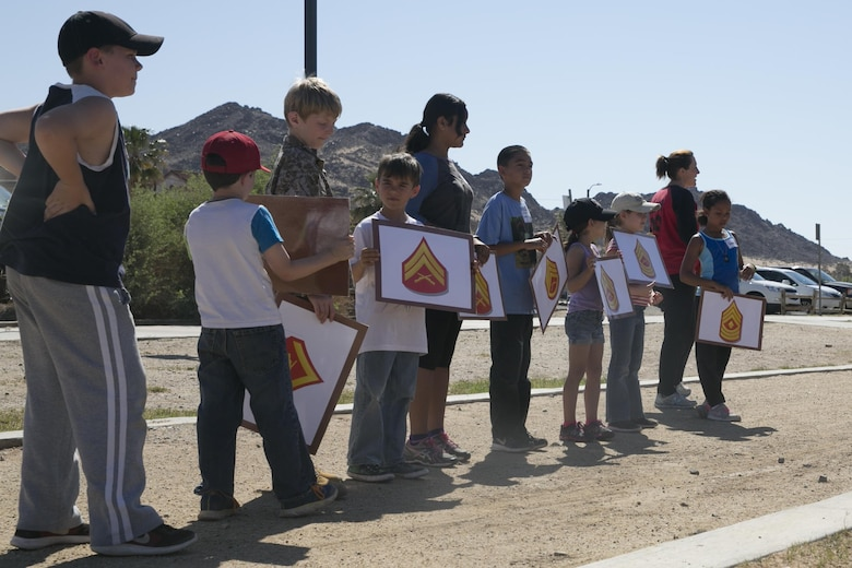 Combat Center children attempt to properly arrange the Marine Corps enlisted rank structure as part of the Lifestyle, Insights, Networking, Knowledge, and Skills annual Combined Arms Exercise for Kids at Felix Field April 20, 2016. (Official Marine Corps photo by Cpl. Thomas Mudd/Released)
