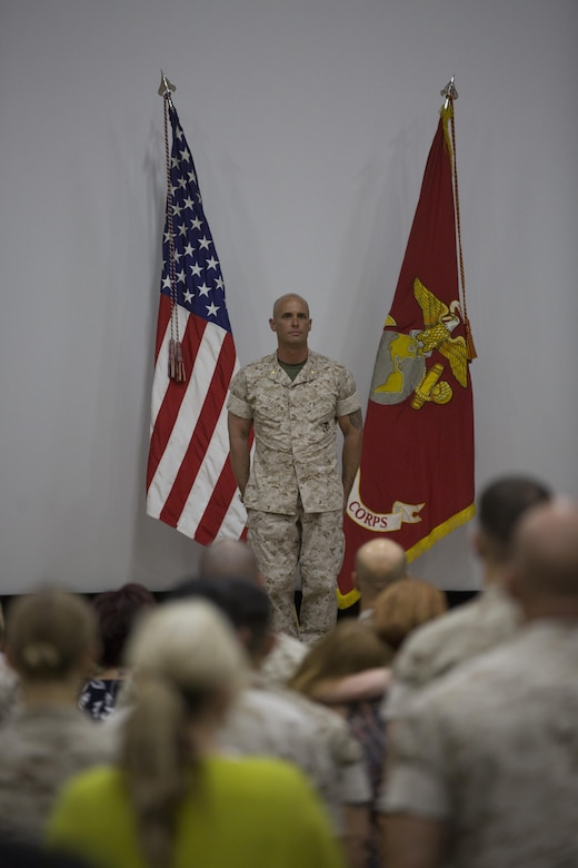 "Maj. Chad E. Craven, commanding officer, Delta Company, Communication Training Battalion, stands at the position of attention during the playing of the ""Marines' Hymn"" during his retirement ceremony at the base theater April 20, 2016. Craven retired after 24-years of honorable service. (Official Marine Corps photo by Cpl. Julio McGraw/Released)"