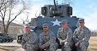 "Sullivan Cup Team: Staff Sgt. Eric Engstrom II of Becket, Massachusetts (left); Sgt. Johnathan Alejandro of Pasadena, California; Pfc. Avery Randle of Monticello, Indiana; and Pvt. Logan Bontrager of Middlebury, Indiana; all tank crew members from 3rd Battalion, 66th Armor Regiment, 1st Armored Brigade Combat Team, 1st Infantry Division, will represent the ""Big Red One"" during the 2016 Sullivan Cup competition May 2-6 at Fort Benning, Georgia. The Sullivan Cup is an annual competition that brings together the best tank crews from the U.S. Army, Marines and international partners and tests them in tank crew maneuver, sustainment and gunnery skills."