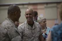 Maj. Chad E. Craven, commanding officer, Delta Company, Communication Training Battalion, talks to friends and collegues after his retirement ceremony at the base theater April 20, 2016. Craven retired after 24-years of honorable service. (Official Marine Corps photo by Cpl. Julio McGraw/Released)