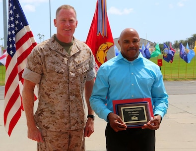Brig. Gen. Edward D. Banta, Commanding General, Marine Corps Installations - West, Marine Corps Base Camp Pendleton, awards Joe Fitts a Federal Length of Service Award for 35 years of federal service at the Civilian Awards Ceremony aboard Camp Pendleton, April 28, 2016. The Civilian Awards Ceremony was held to recognize 13 Camp Pendleton civilian employees for Federal Length of Service Awards and one for a Professional Housing Management Association Award.