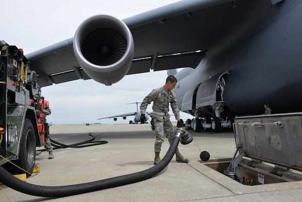 Airman 1st Class Connor Starr removes a fuel hose from a hydrant April 26 at Travis Air Force Base, Calif. Starr was refueling a C-5M Super Galaxy. (U.S. Air Force photo by Senior Airman Amber Carter)