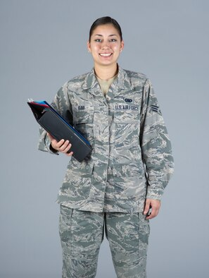 Senior Airman Cinnamon Kava, 60th Logistics Readiness Squadron decentralized supply support, poses for a photo in December 2014 at Travis Air Force Base, Calif.