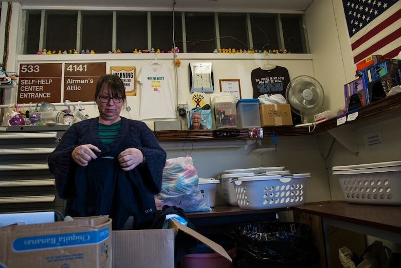 Anne Goodwin, a Chief Master Sgt. Gene Airman's Attic core volunteer, sorts clothes into baskets April 12, 2016 at Scott Air Force Base, Ill. The Airman's Attic provides many items for Airmen including clothes, food, furniture, office supplies and more. (U.S. Air Force photo by Airman 1st Class Gwendalyn Smith)