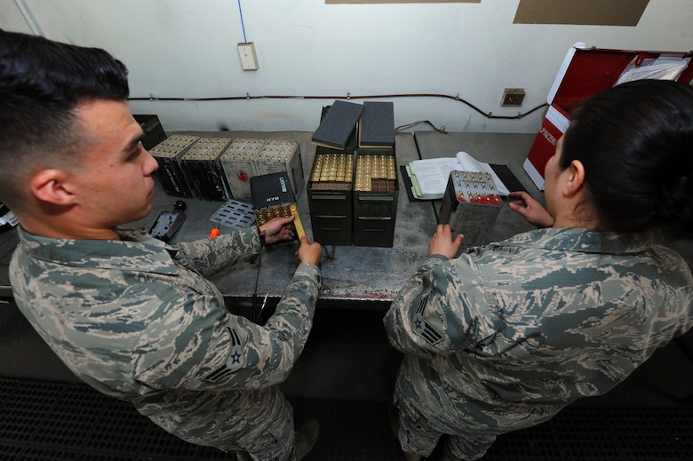 From left U.S. Air Force Senior Airman Micah Rodriguez and Airman 1st Class Alias C. Arzvaga, 19th Maintenance Squadron stockpile surveillance crewmembers, load flare sticks into containers April 21, 2016, at Little Rock Air Force Base. The 19th MXS munitions flight assembles, inspects and stores more than 1,400 types of weapons and ammunitions. (U.S. Air Force photo by Airman Kevin Sommer Giron)