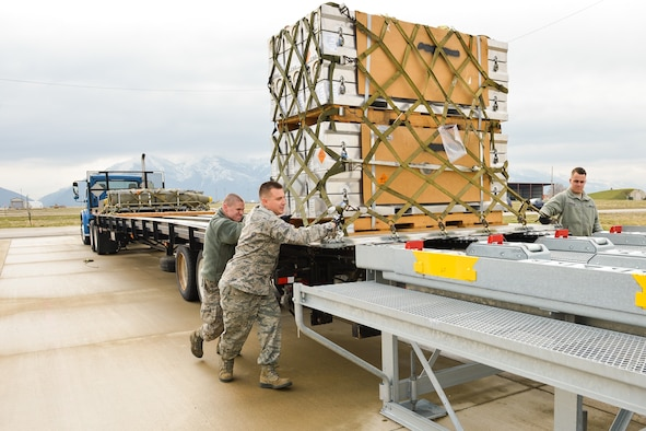 "Ammo Airmen assigned to the 649th Munitions Squadron load air-transportable munitions containers onto a staging platform during STAMP training March 31, 2016, at Hill Air Force Base, Utah. 649th MUNS provides ""World-Class Munitions Support to the Warfighter."" (U.S. Air Force photo by R. Nial Bradshaw)"