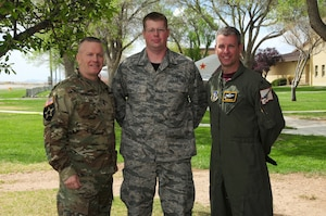 Command Sergeant Major John Wayne Troxell, Senior Enlisted Advisor to the Chairman of the Joint Chiefs of Staff and Col. Robert Reyner pose with Senior Airmen Aaron Sturgill, who is the Airmen of the Year award winner, on 15 April 2016, at the 150th Special Operations Wing, Kirtland AFB, N.M. (Air National Guard Photo by Master Sgt. Paula Aragon)
