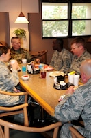 Army Command Sergeant Major John Wayne Troxell, Senior Enlisted Advisor to the Chairman of the Joint Chiefs of Staff and Chief Master Sergeant Mitchell Brush, Senior Enlisted Advisor for the National Guard Bureau,  both enjoy a breakfast with Airmen and Soldier of the Year Award winners on 15 April, 2016. Both SEAC's offering mentorship and guidance as well as listening to the concerns of the members. (Air National Guard Photo by Master Sgt. Paula Aragon)