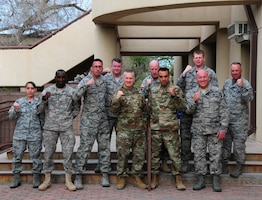 Army Command Sergeant Major John Wayne Troxell, Senior Enlisted Advisor to the Chairman of the Joint Chiefs of Staff and Chief Master Sergeant Mitchell Brush, Senior Enlisted Advisor for the National Guard Bureau, pose with fists up for a group photo with the Airmen and Soldier of the Year Award winners as well as other members of the New National Guard, on 15 April, 2016. Both SEAC's offered mentorship and guidance as well as listening to the concerns of the members during their morning breakfast at the Thunderbird Inn located on Kirtland AFB, N.M. (Air National Guard Photo by Master Sgt. Paula Aragon)