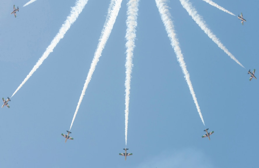 Pilots, with the United Arab Emirates Air Force Aerobatic Display Team, demonstrate the Al Fursan aircrafts inflight capabilities during the International Marrakech Airshow in Morocco on Apr. 27, 2016. Several United States, independent and government owned aircraft were displayed at the expo in an effort to demonstrate their capabilities to a broad audience of individuals from approximately 54 other countries. (DoD News photo by TSgt Brian Kimball)