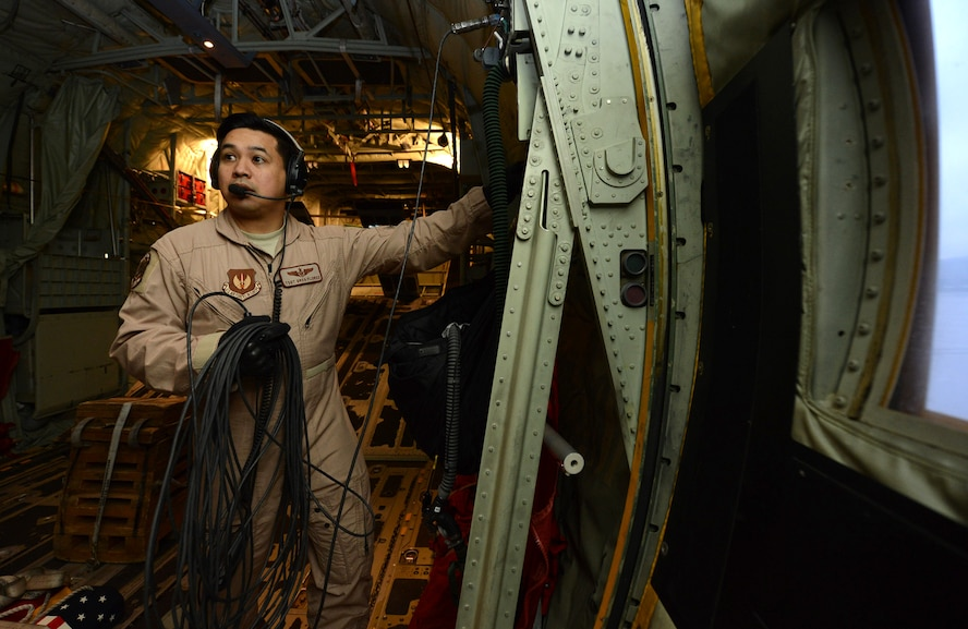 U.S. Air Force Technical Sergeant Gregory Flores, a loadmaster with the 37th Airlift Squadron (AS), communicates with the other aircrew during pre-flight checks on a C-130J Hercules prior to take off from Ramstein Air Base, Germany on Apr. 26, 2016. TSgt Flores is part of a six-man flight crew entrusted with transporting the aircraft to the 2016 International Marrakech Airshow in Morocco and showcasing the aircrafts capabilities. (DoD News photo by TSgt Brian Kimball)