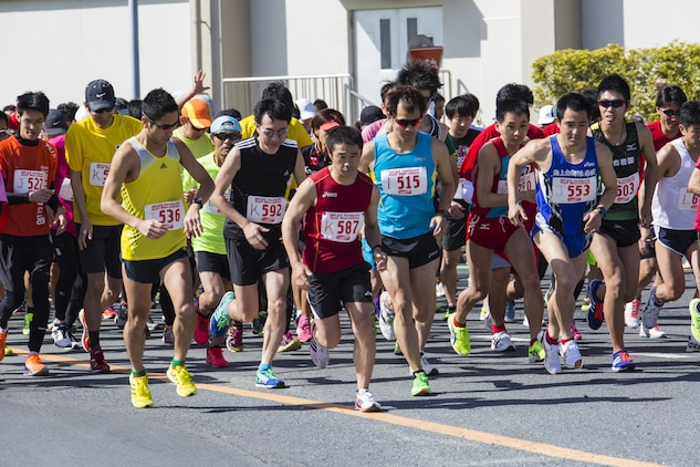 Station residents and Japanese participants begin a half marathon during the 49th Kintai Marathon on Marine Corps Air Station Iwakuni, Japan April 17, 2016. With more than 500 athletes, the marathon is one of the few events that invites Japanese citizens on the air station and provides a great opportunity for MCAS Iwakuni personnel to show support of their host nation through running, said Mai Tajima, SemperFit recreation specialist. The full marathon first place for the men was Yoshihisa Nagashita, 34, completing at 2 hours, 40 minutes, 21 seconds, and for the women was Hitomi Matsubara, 45, completing at 3:27:25. (U.S. Marine Corps photo by Cpl. Nathan D. Wicks /Released)