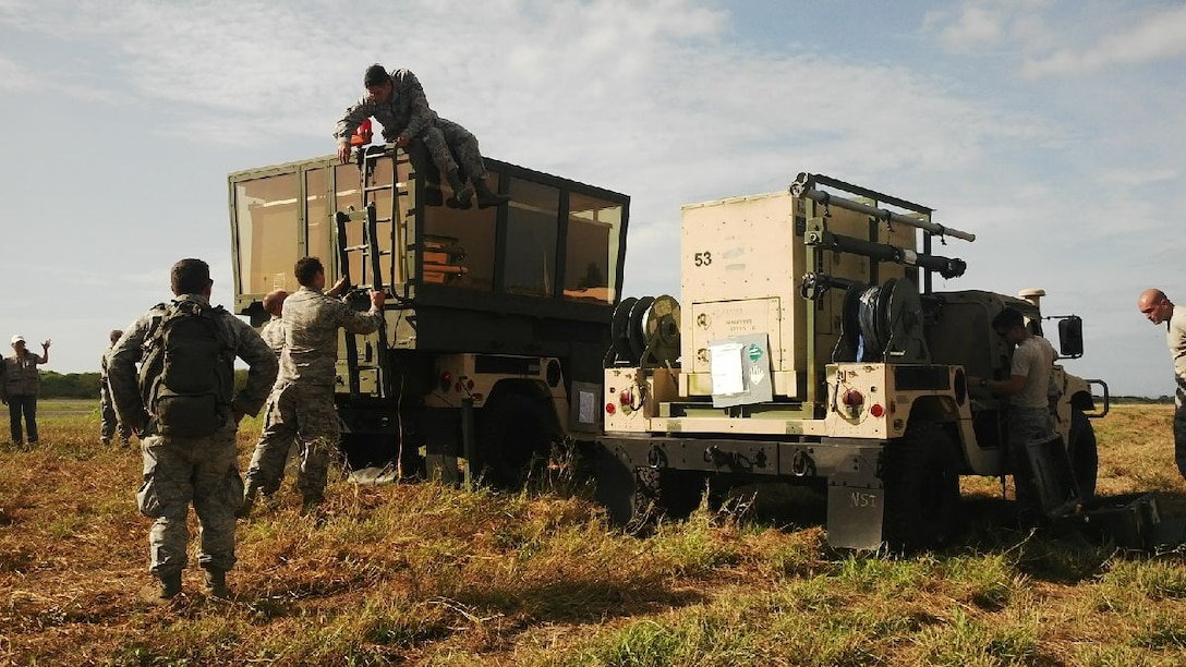 An Air Force team sets up a mobile air traffic control tower at Eloy Alfaro International Airport in Manta, Ecuador, April 26, 2016. The portable tower will help local controllers increase the flow of humanitarian aid entering the country. The United States, in coordination with the Ecuadorian government, deployed 12 U.S Airmen to Ecuador to support international relief efforts for victims of a 7.8-magnitude earthquake. (Courtesy photo/U.S. Embassy Quito)