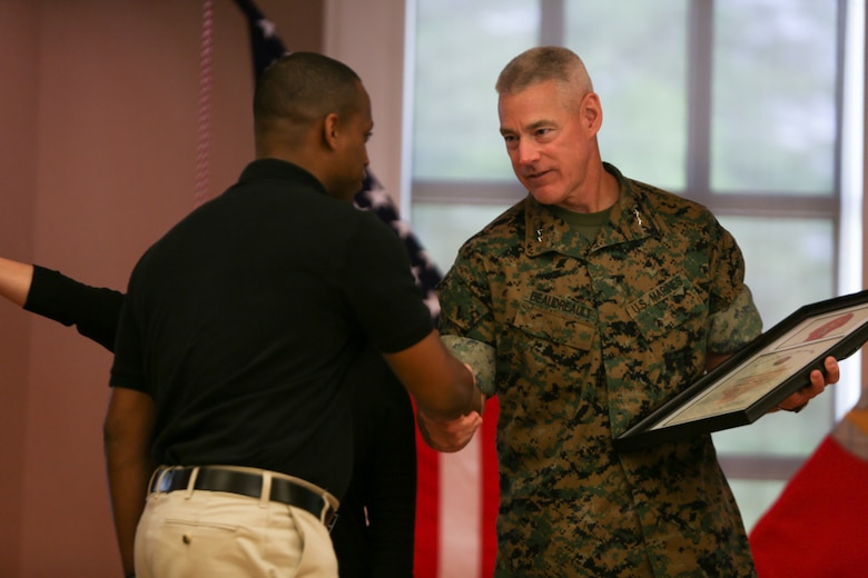 Major Gen. Brian Beaudreault, commanding general of 2nd Marine Division, commemorates Staff Sgt. Terrance Shorty, the career planner for 3rd Battalion, 6th Marine Regiment, for his hard work and dedication to volunteering with the Marines in his unit, during a ceremony held at Camp Lejeune, N. C., April 27, 2016. The 2nd Marine Division honored numerous Marines from all around its units for giving their time back to the community. (U.S. Marine Corps photo by Cpl. Melodie Snarr/Released)