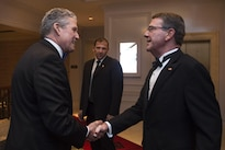 Defense Secretary Ash Carter, right, is greeted by Business Executives for National Security Chief Operating Officer Henry Hinton as he arrives for the BENS Eisenhower Award dinner in Washington D.C., April 28, 2016. Carter was presented the 2016 Eisenhower Award. DoD photo by Senior Master Sgt. Adrian Cadiz