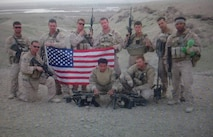 Marines are known as the most elite fighting force in the nation. Earning the prestigious Eagle, Globe and Anchor means joining a brotherhood and sisterhood that consists of about 183,883 service members; equating to around 13% of the nation's military manpower. Sergeant Michael Butler (pictured far right holding the flag) a recruiter out of Recruiting Sub Station Mobile, Recruiting Station Montgomery, is one of the people who have the honor of calling himself one of the few and the proud. (U.S. Marine Corps courtesy photo)